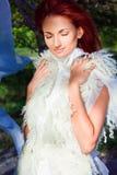 Beautiful woman in white in sun beam Stock Photo