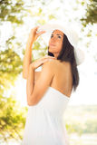 Beautiful woman with white sun hat Stock Photos