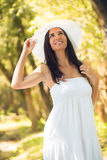 Beautiful woman with white sun hat Royalty Free Stock Photography