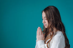 Beautiful woman in white sweater folded her hands in prayer to G Royalty Free Stock Photography