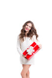 Beautiful woman in white sweater holding a red box with a gift. Stock Photos