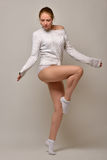 Beautiful woman in white sweater and panties dancing in studio Royalty Free Stock Image