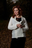 Beautiful woman in white sweater walks in the Park Royalty Free Stock Photography