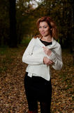 Beautiful woman in white sweater walks in the Park Royalty Free Stock Image