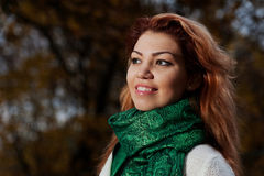 Beautiful woman in white sweater walks in the Park Royalty Free Stock Images