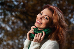 Beautiful woman in white sweater walks in the Park Stock Photo