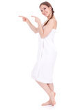 Beautiful woman in white towel pointing Royalty Free Stock Photos