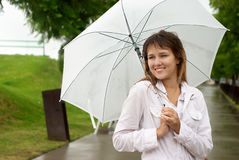 Beautiful woman with a white umbrella Royalty Free Stock Photo