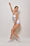 Beautiful woman in white underwear dancing Stock Images