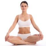 Beautiful woman white underwear sits cross legged Stock Photography
