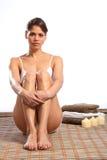 Beautiful woman in white underwear sitting on mat Stock Image