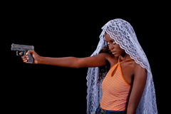 Beautiful woman in a white veil with a gun Royalty Free Stock Photo