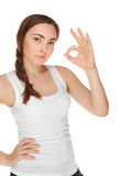 Beautiful woman in white vest giving okay sign isolated Stock Photography