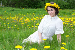 Beautiful woman in white vintage dress with flower wreath on sum Royalty Free Stock Photos