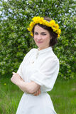 Beautiful woman in white vintage dress on summer meadow Stock Photos