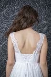Beautiful woman in white wedding dress with corset Stock Photos