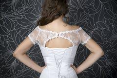 Beautiful woman in white wedding dress with corset Stock Photo