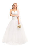 Beautiful woman in a white wedding dress royalty free stock images