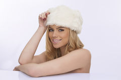 Beautiful woman in a white winter cap Stock Image