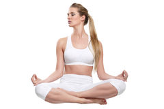 Beautiful woman on white  yoga sitting Stock Photos