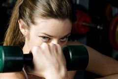 Beautiful woman who exercise in the sport club. Royalty Free Stock Photos