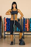 Beautiful woman who exercise in the sport club. Stock Image