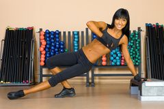 Beautiful woman who exercise in the sport club. Stock Photography