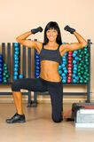 Beautiful woman who exercise in the sport club. Royalty Free Stock Images