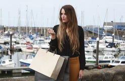 Beautiful woman who has been shopping Stock Image