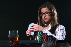 Beautiful woman who playing poker Stock Photo