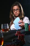 Beautiful woman who playing poker Stock Images