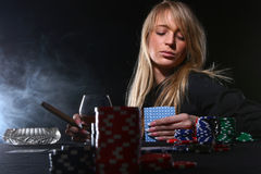Beautiful woman who playing poker Stock Photos