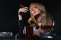 Beautiful woman who playing poker Stock Images