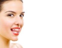 Beautiful woman who puts tongue out Stock Image