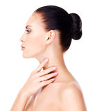Beautiful woman who touches the neck by fingers stock images