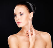 Beautiful woman who touches the neck by hands Royalty Free Stock Photo