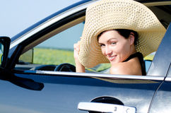 Beautiful woman in wide brimmed hat Stock Photos