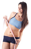 Beautiful woman will measure a waist. Isolated Stock Image