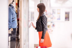 Beautiful woman window shopping Stock Photos