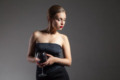 Beautiful woman with wine glass, retro stylization Royalty Free Stock Photography