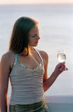 Beautiful woman with wineglass of champagne royalty free stock photography
