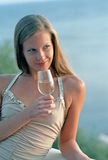 Beautiful woman with wineglass of champagne on b Royalty Free Stock Photography
