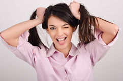 Girl laughing holding her hair. Royalty Free Stock Images
