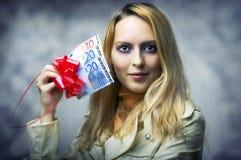 Beautiful woman winner holding 50 euro. Fashion portrait of young beautiful woman winner holding money - 50 (fifty) euro Royalty Free Stock Photography