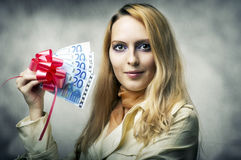 Beautiful woman winner holding money Royalty Free Stock Photos