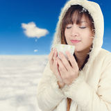 Beautiful Woman with winter anorak and mug Stock Image