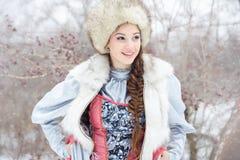 Beautiful woman winter. Beautiful cheerful woman smiling in winter Stock Image