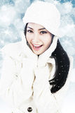 Beautiful woman in winter clothes on blue lights Stock Photos