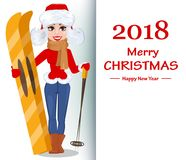 Beautiful woman in winter clothes holding skis and standing near. Merry Christmas greeting card. Beautiful woman in winter clothes holding skis and standing near Royalty Free Stock Image