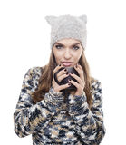 Beautiful woman with winter clothes and mug of coffee Stock Photo
